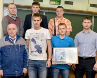 Отмеченные приказом генерального директора c первым заместителем генерального директора Э. Баалем (второй слева).  Фото Марса Биктимирова