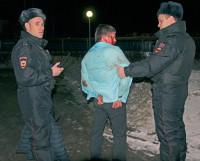 А. Тишинин (слева) и А. Гильмудинов (справа) на задержании.