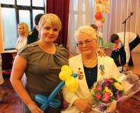 2 сентября 2013 года. Жанна Александровна Трубина (справа) на торжественной линейке в северодвинской общеобразовательной средней школе-интернате. Фото автора